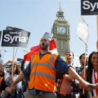 Protesters in Parliament Square in central London demonstrate against possible strikes on the...