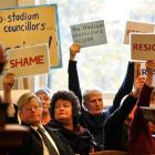 Protesters including former Stop the Stadium president Bev Butler (second from left) show their...