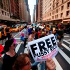 Protesters march through midtown Manhattan while demonstrating in solidarity with the Russian...