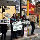 Protesters stand in Princes St, Dunedin, outside the office of Cabinet Minister Michael Woodhouse...