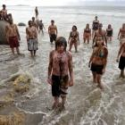 Protesters take part in an anti-oil exploration demonstration at Moeraki Beach yesterday,...