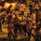 Protesters throw stones during a clash between supporters and opponents of ousted Egyptian...