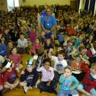 Pupils and staff at Anderson's Bay School celebrate caretaker Miguel Rodriguez's 20 years of...