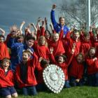 Pupils from Omakau School celebrate with the shield this week.