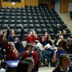 Pupils raise their hands to take part in the spot prize section of the quiz. Photos by Liam...