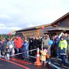 Opening day . . . Visitors take in aircraft displays in front of the new Te Anau Airport terminal...