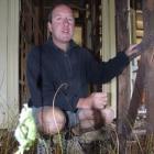 Buckingham Cottages Trust chairman David Clarke, of Arrowtown, surveys the state of Romans...
