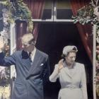 Queen Elizabeth and Prince Philip greet their Dunedin subjects from the balcony of the Law Courts...