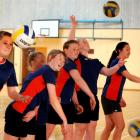 Queen's High School year 10 pupils practising their volleyball skills yesterday are (from left)...