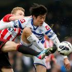 Queens Park Rangers' Park Ji-Sung (R) challenges Sunderland's Sebastian Larsson during their...