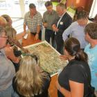 Queenstown Airport Corporation chief executive Scott Paterson (top, third from left) talks to...