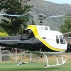 Queenstown helicopter pilot Mitchell Gameren's coffin is flown in for a funeral service at Lake...