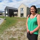 Queenstown Lakes Community Housing Trust executive officer Julie Scott stands in front of two of...