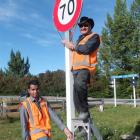 Queenstown Lakes District Council contractors from Downer, Tim Dhinakar and Mike Fraser, put up...