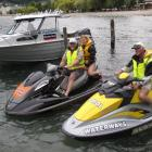 Queenstown Lakes harbourmaster Marty Black (left) with Jessica Forrest (16), of Invercargill and...
