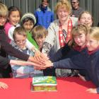 Queenstown Lakes  Mayor Vanessa van Uden and local schoolchildren cut a cake celebrating five...