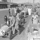 Racers and their cars at the Dunedin street race wharf circuit in 1955. Photo: Evening Star