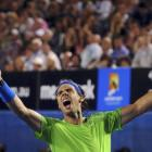 Rafael Nadal of Spain celebrates after defeating Roger Federer of Switzerland in their semifinal...