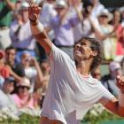 Rafael Nadal of Spain celebrates defeating Novak Djokovic of Serbia in their men's singles semi...