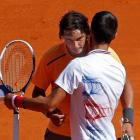 Rafael Nadal of Spain hugs Novak Djokovic of Serbia after their Monte Carlo Masters final in...