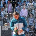 Rafael Nadal of Spain sprays champagne after winning the Madrid Open final against Stanislas...