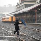 A pedestrian cuts across the railway lines next to the Dunedin Railway Station yesterday. Photo...