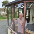 Ravensbourne resident Jim La Rooy looks out a self-cleaning glass window, which was installed by...