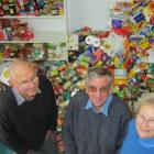 Ray Meikle (left), and Rex and Dorothy Murray take time out from sorting about a quarter of the...