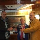 Real Journeys chief executive Richard Lauder, Joan Hall-Jones and David Hall-Jones toast to the...