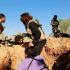 Rebel fighters from Harakat Hazm (Hazm movement) take cover after a mortar shell hits near them...