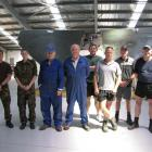 Rebuilding a decommissioned air force Skyhawk in Wanaka this week, (from left) Chris Watty and...