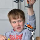 Micah Caldwell plays with Lego toys given to him after he was injured when a Noddy train...