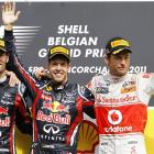 Red Bull driver Sebastian Vettel (C) of Germany celebrates on the podium with second-placed team...