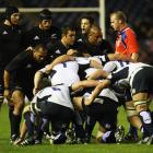 Referee Wayne Barnes presides over the setting of a scrum during the All Blacks' match against...