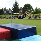 Regan Hucklebridge (13), of Cromwell College, clears the bar in the boys 13-plus high jump.