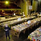 Doug Lovell takes a look at one of the hundreds of unmarked books now selling for $1 at the...