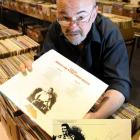 """Regent Theatre Anything But Books Sale volunteer Barry Morris with an LP """"signed"""" by Elvis..."""