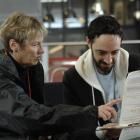 Registrar of Electors field officer Kay Patrick helps psychology student Matt Moore (25) fill in...
