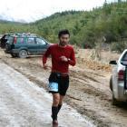 Rei Ishikawa (30), of Dunedin, strides along during the 50km race.