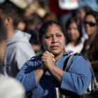 Relatives of inmates wait for news of their relatives outside the state prison in Apodaca, on the...