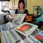 Relics music store assistant Sarah Williamson unpacks a collectable Bob Dylan album boxed set...