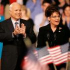 Republican Alaska Gov. Sarah Palin speaks as Republican presidential candidate, Sen. John McCain,...