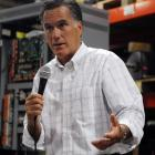 Republican presidential candidate Mitt Romney speaks to employees during a visit to Stanley...