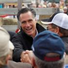 Republican presidential nominee Mitt Romney shakes hands with supporters after a campaign rally...