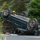 Rescue workers at the scene of a fatal car crash in Waitakere. Photo / New Zealand Herald / Jason...