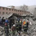 Rescue workers search for survivors at the site of a collapsed building in Yushu county in...