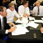 Reserve Bank Governor Dr Alan Bollard, right, speaks in at a workshop at the Job Summit. Photo by...