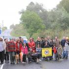 Residents of Seacliff on Coast Rd last night demonstrate for action to have the speed limit...