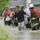 Residents walk in a flooded street to evacuate in Nagoya, central Japan, yesterday. Photo:...