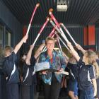 Retiring Elm Grove principal Jenny McDonald is given a hockey stick guard of honour by pupils at...